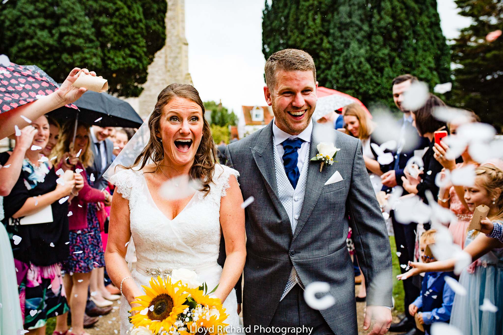 happy couple with confetti at St Mary's church Gosport
