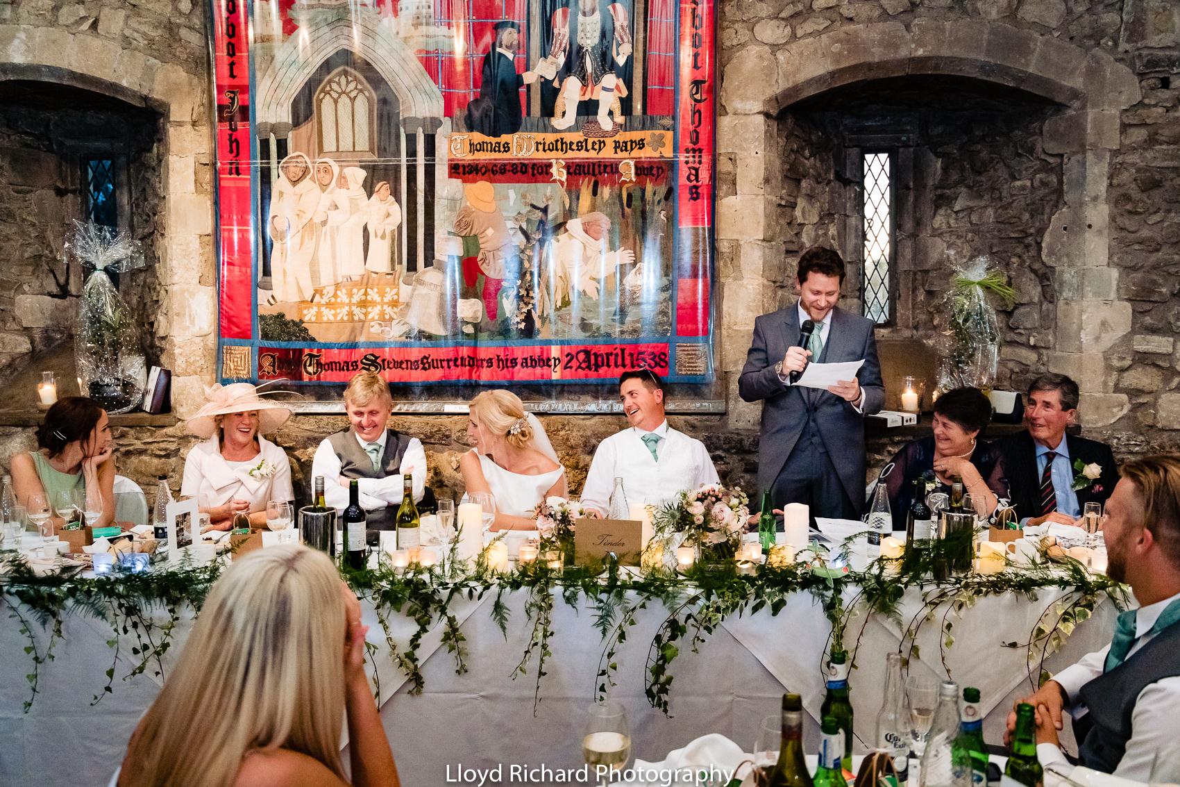 wedding guest laughing at speech at Beaulieu Abbey Domus