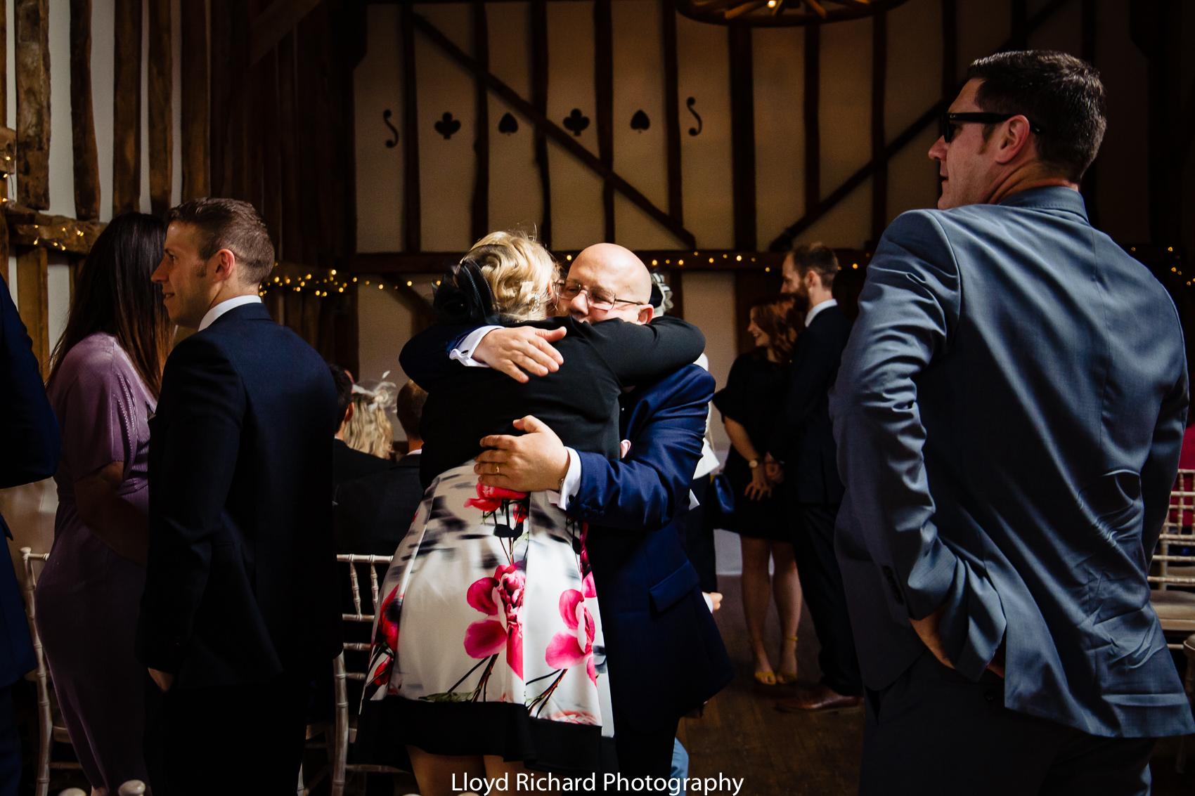 wedding guest hugging at Pitt Hall Barn