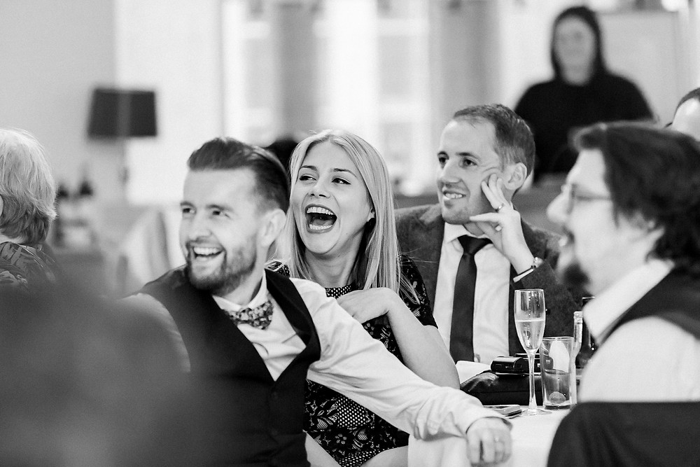 guests lauging at speech