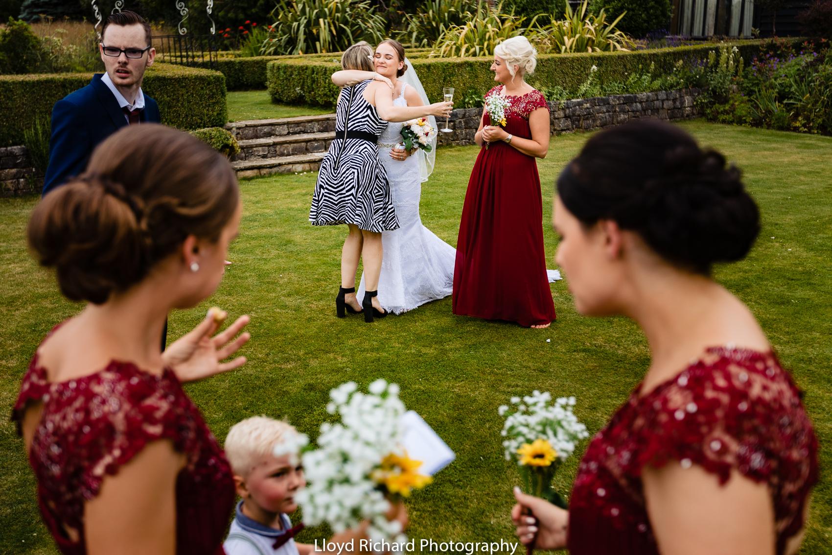 hugging at Cain Manor wedding