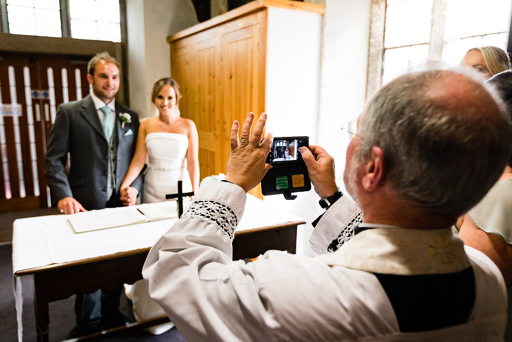 vicer taking a photo of the bride and groom