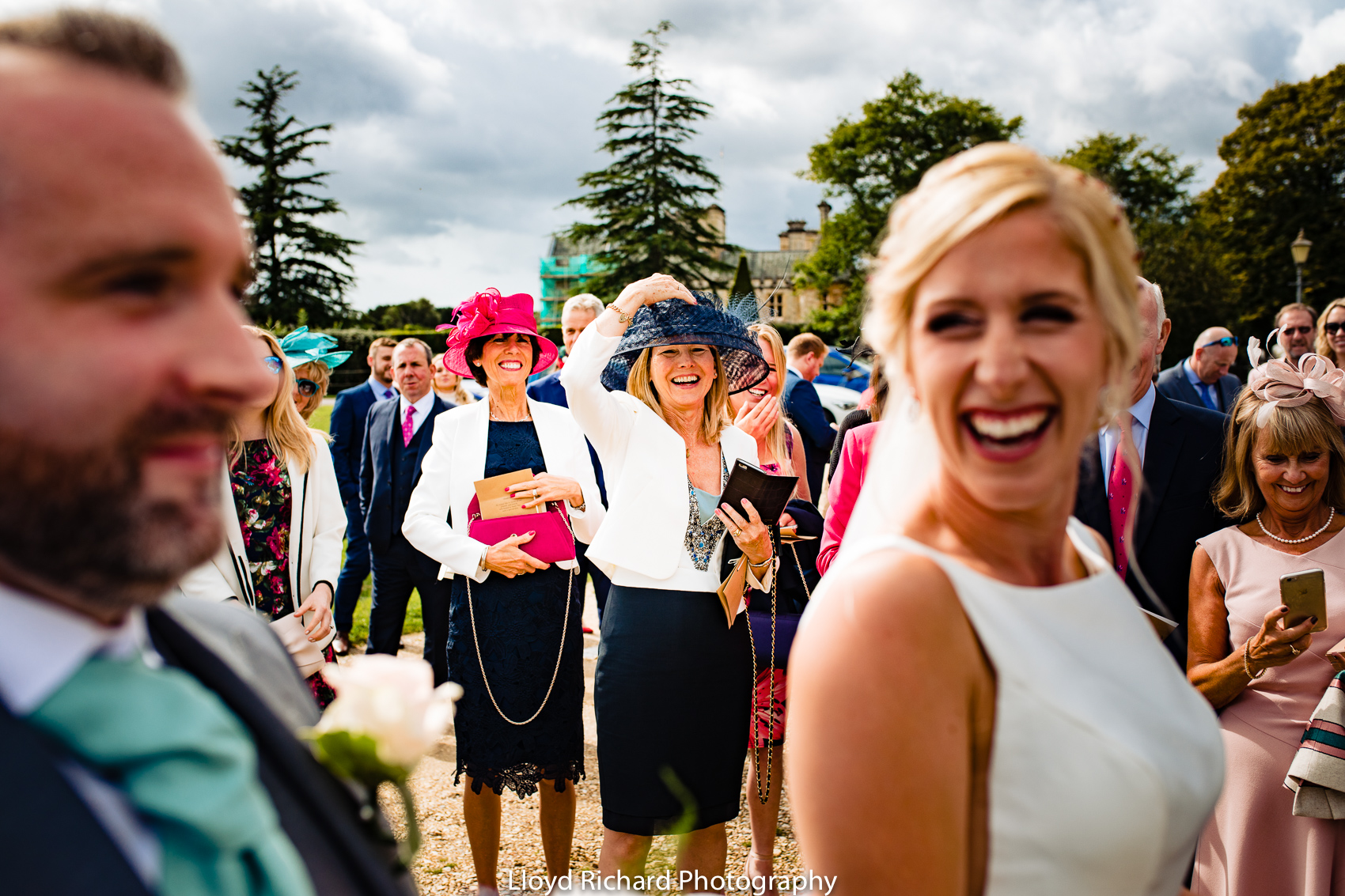 happy wedding guest at Beaulieu Abbey Domus