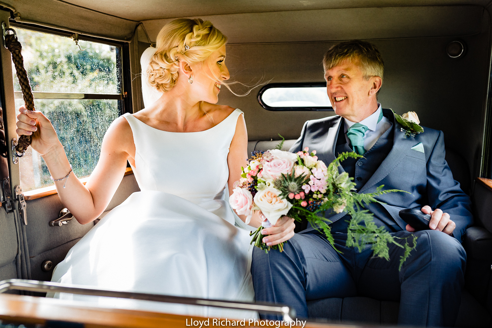 Bride and father travelling in wedding car to Beaulieu Abbey Domus