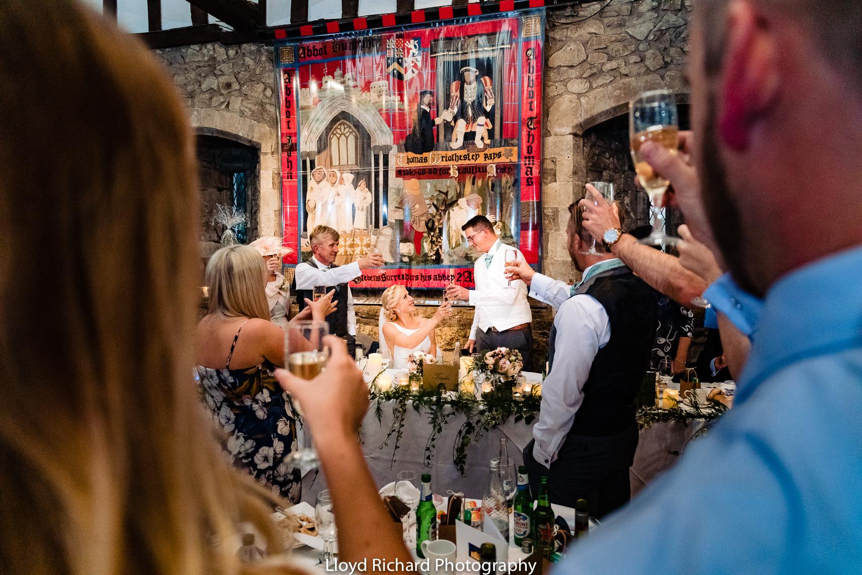 wedding couple toasting at Beaulieu Abbey Domus