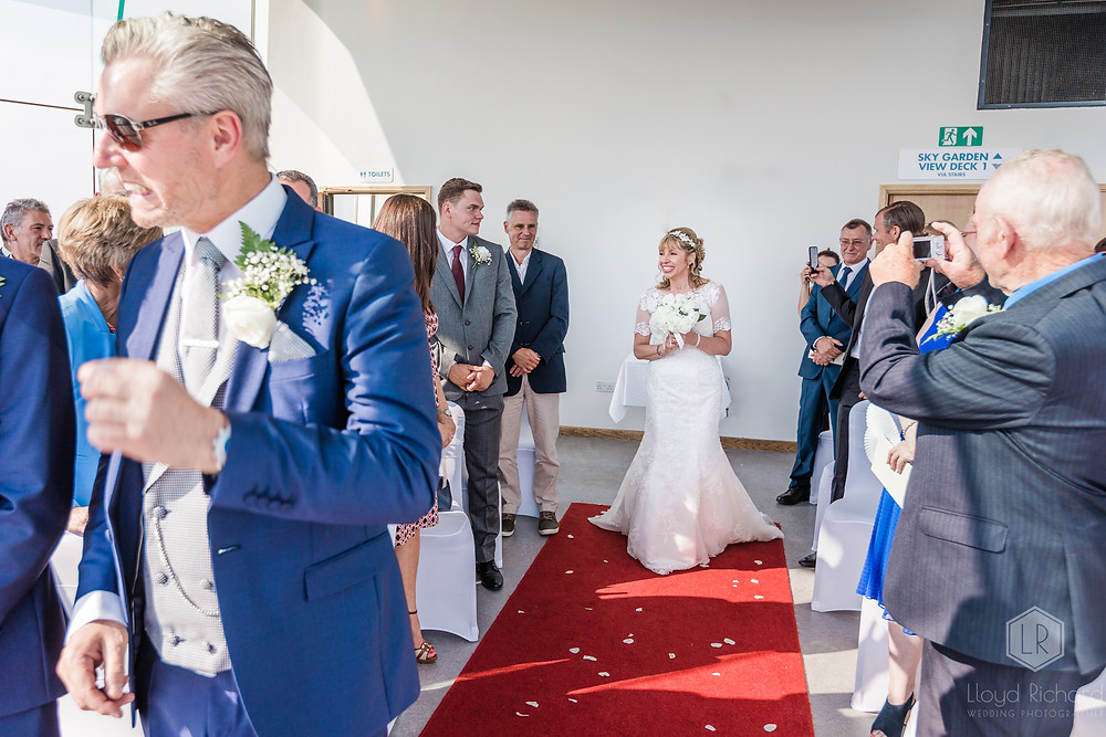bride walking down the aisle at spinnaker tower