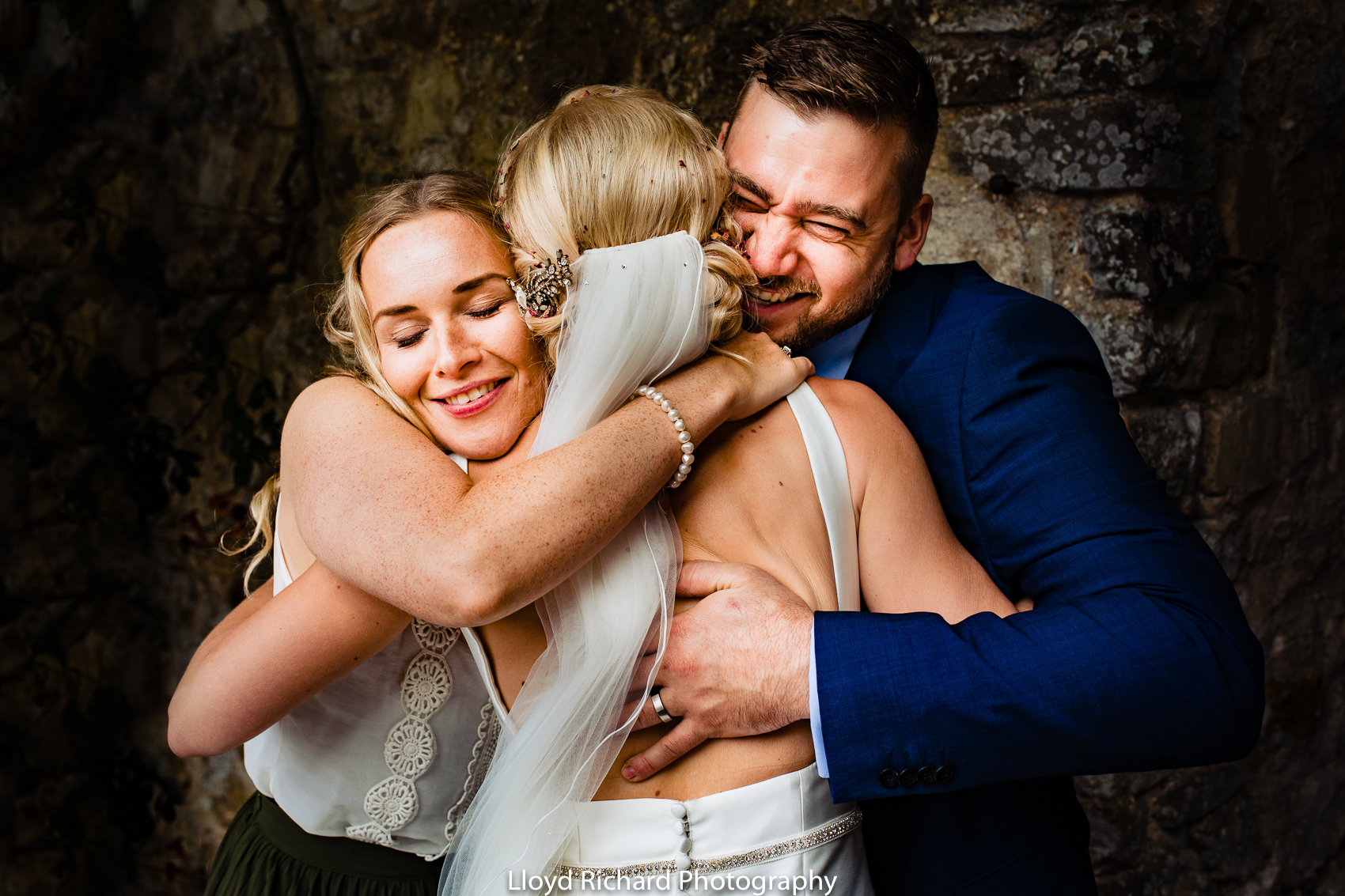 wedding guests hugging bride Beaulieu Abbey Domus
