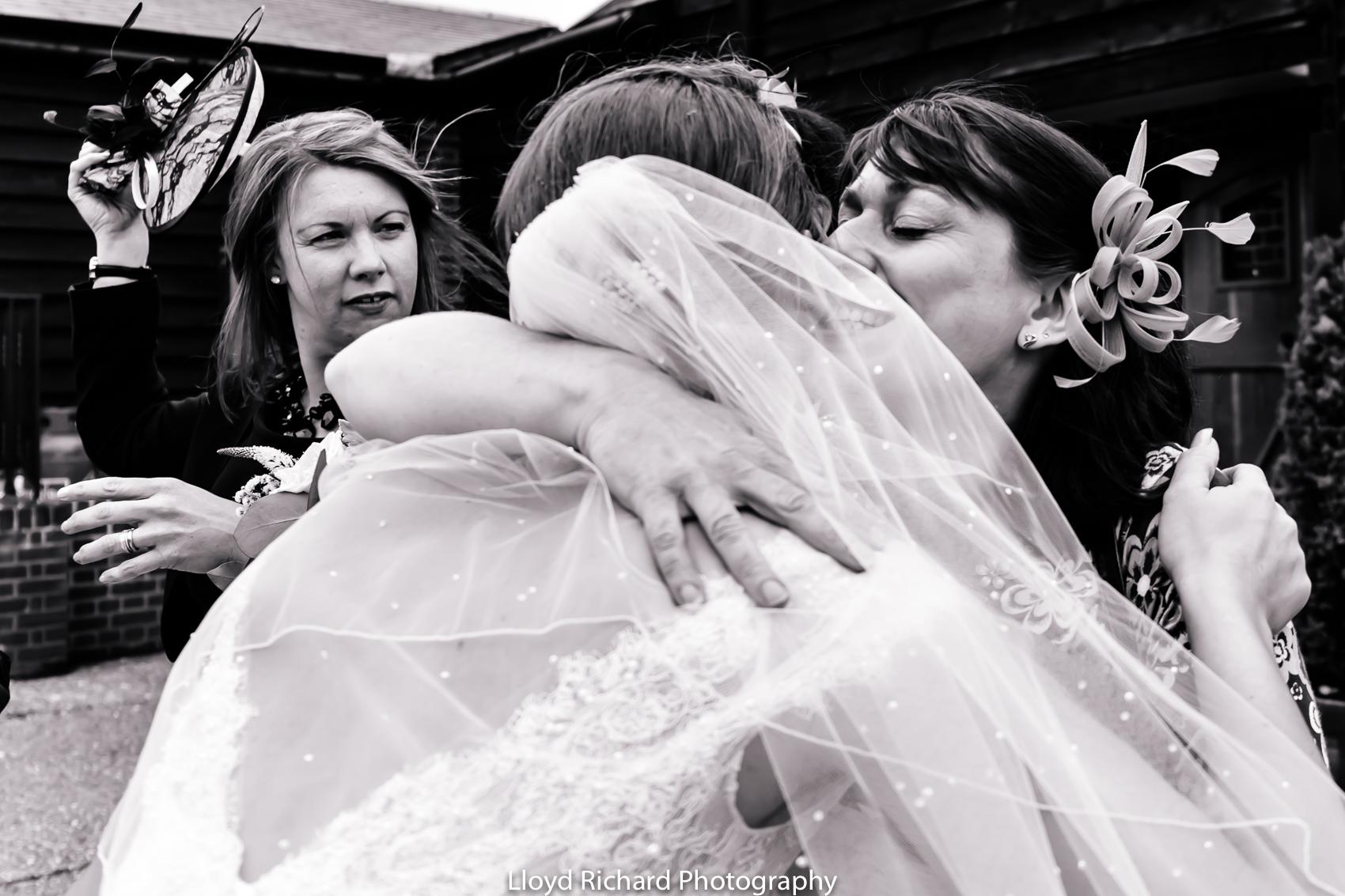 bride hugging guests at Pitt Hall Barn