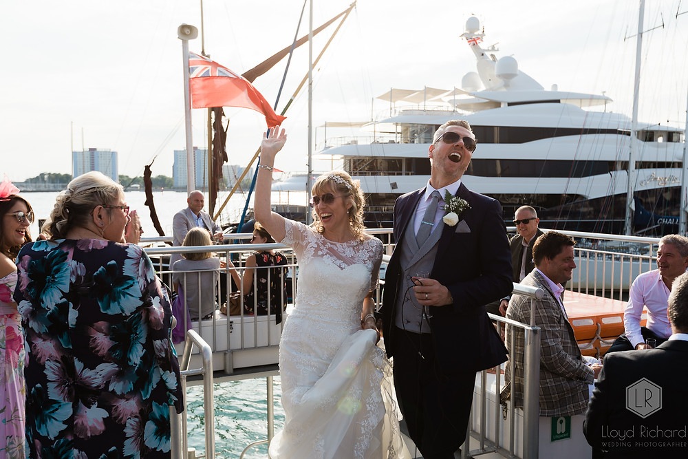 Bride and groom walking on the boat