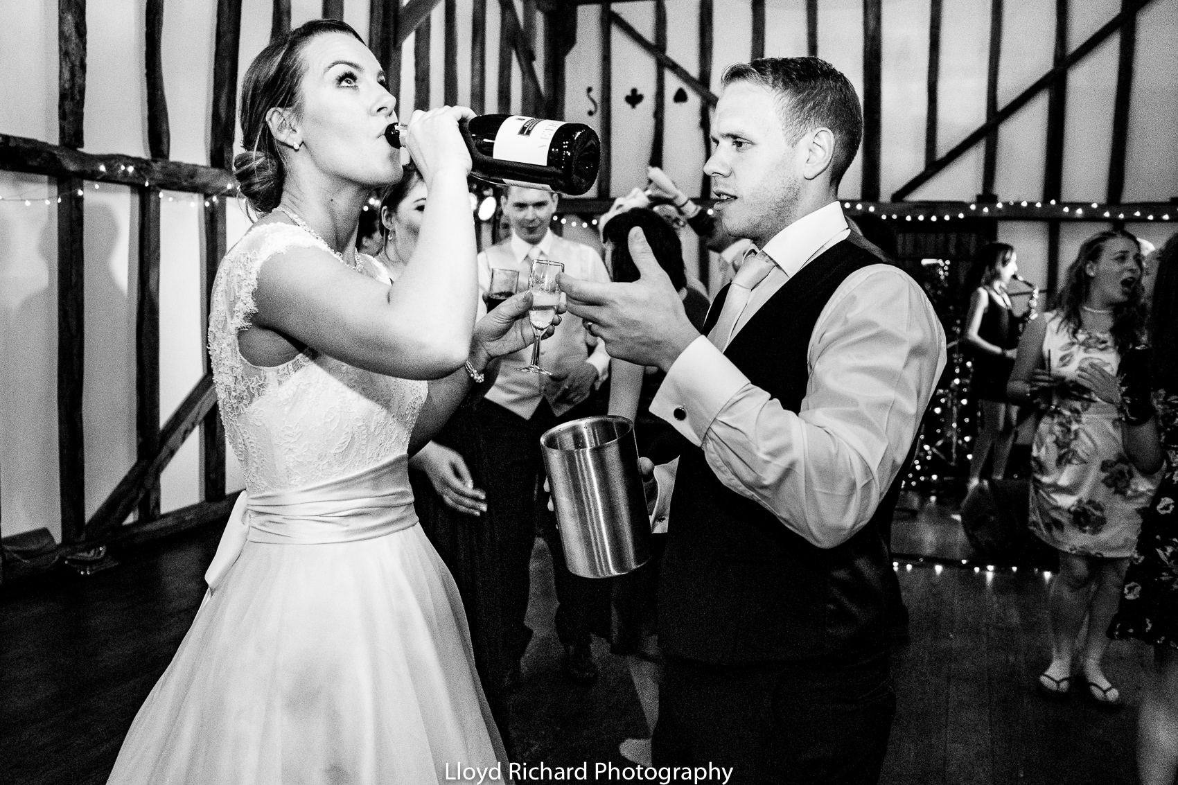 bride drinking out of a bottle at Pitt Hall Barn
