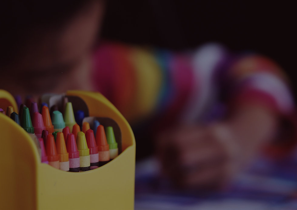 Crayons%20beside%20child%20coloring_edited.jpg