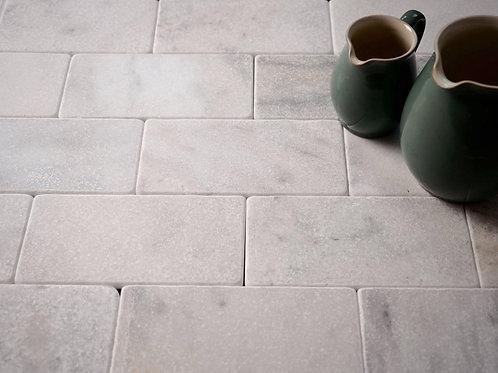 White marble tiles Carrara