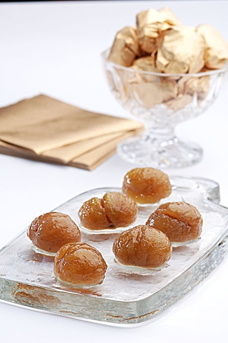 candied chestnuts on a glass board, some