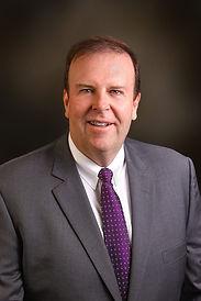 Scott-Barlow-CEO_brown-e1507911471220.jp