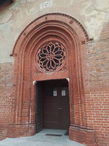 S.Cristoforo,il portale con rosone.jpg