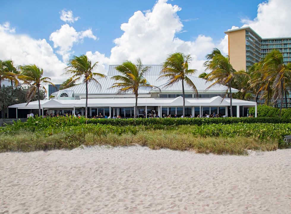Here is the exterior of JB's directly on the beach looking west at the terrace.