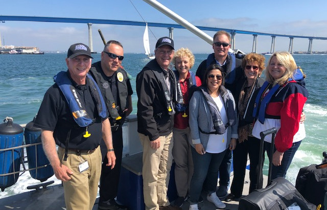 Supervisor Jim Desmond and his staff with SDHP department on Fire Storm boat