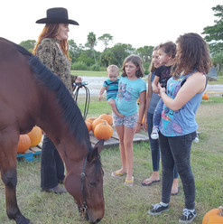 Carly Batts and Bear spread a little their special magic to the Pumpkin Patch Kids