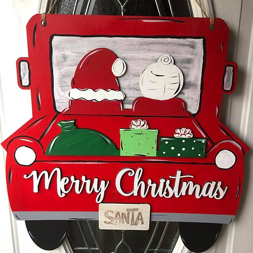 wooden doorhanger with Mr, and Mrs. Claus