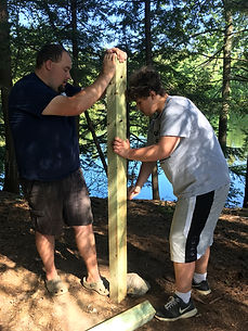 Students work with Bryant Pond staff to desgn and build a PFD and paddle station that is easier to use and more accessible to campers