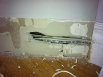 Wires behind baseboard