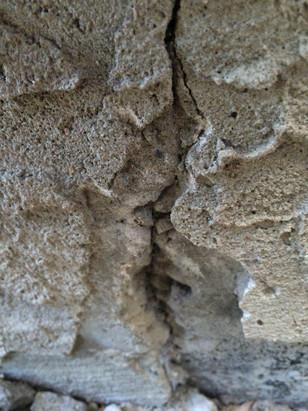 Unsealed stucco crack