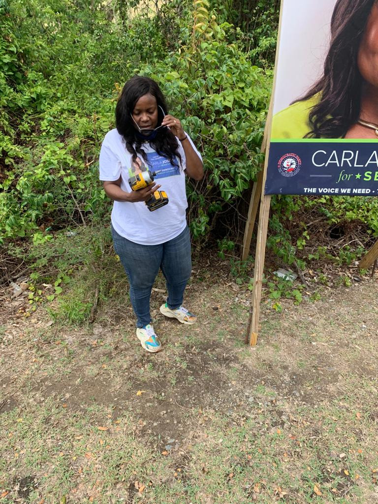 Installing campaign posters in Coral Bay St. John. So Much Fun!
