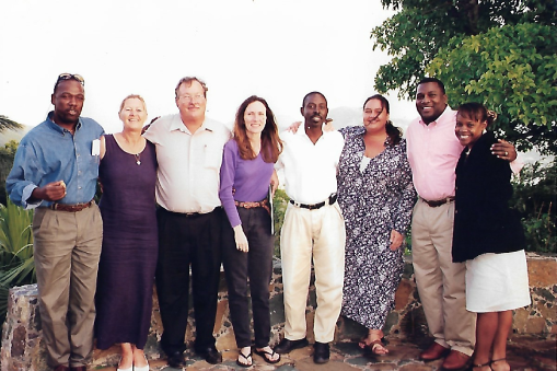 Carla Joseph standing with EAST Board members after an Annual Meeting