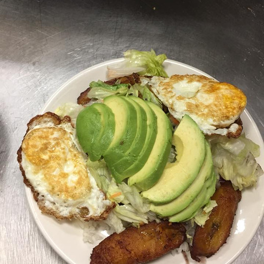 Veggie Dish Topped with Two Eggs and Avacado