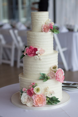 4 tier buttercream and sugar flowers