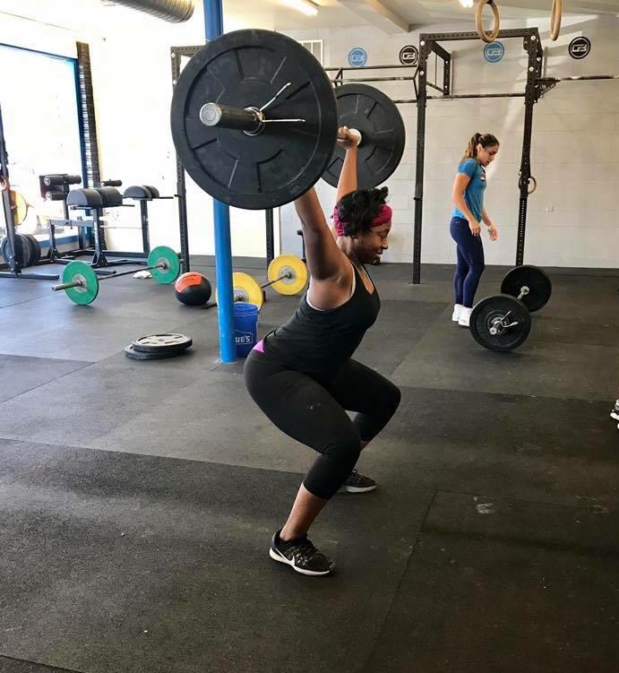 Athlete: Diamone standing up a squat snatch