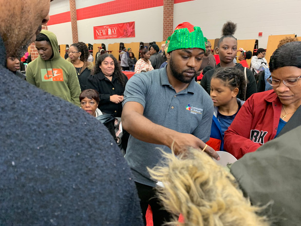 On the Frontline! CIS of Atlanta Spreads Christmas Cheer at Banneker High School