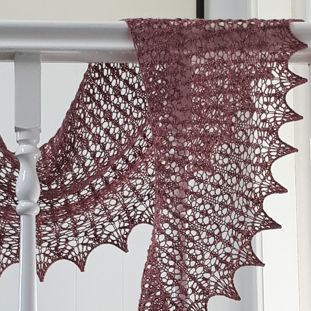 Rose Meadow shawl by Cath Ward, using Ginseng fingering weight yarn in Rose Wine colourway.