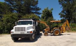 Dump truck and backhoe