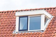 Dormer window on  roof of house with ora