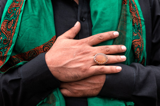 Man with Ring and Green Scarf.jpg