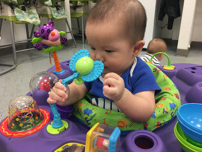 Infant with toys