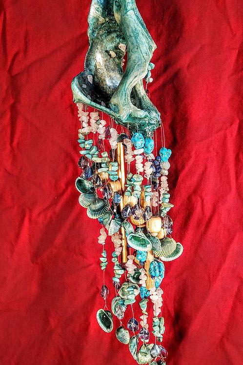 #108  Large ocean modified vertical oriented teal Whelk