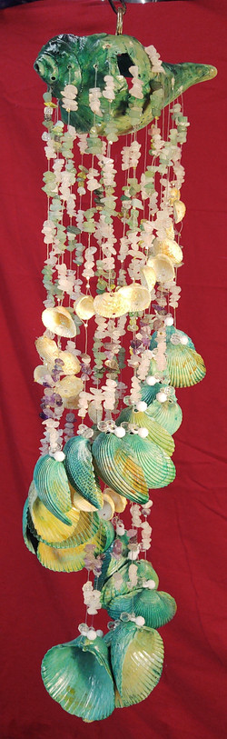 #108  large Welch shell with 28 clam she