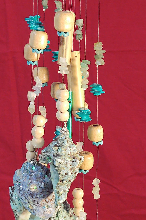 #101 Baby Blue Welch with 9 spiny cone shells.   9.2 oz