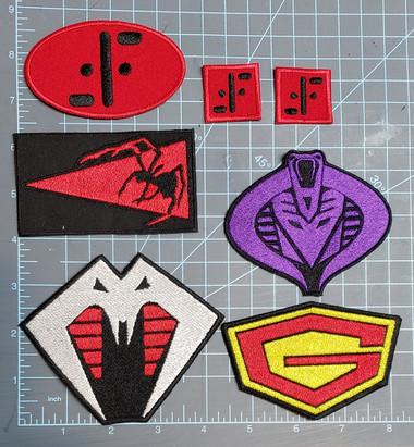 V uniform patches, Cobra Stinger, Decepticon/Cobra, Black Major Replicant, G-Force/Gatchaman/Battle of the Planets