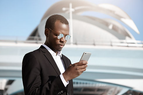 African business man and Carhoot Member getting assistance through the app