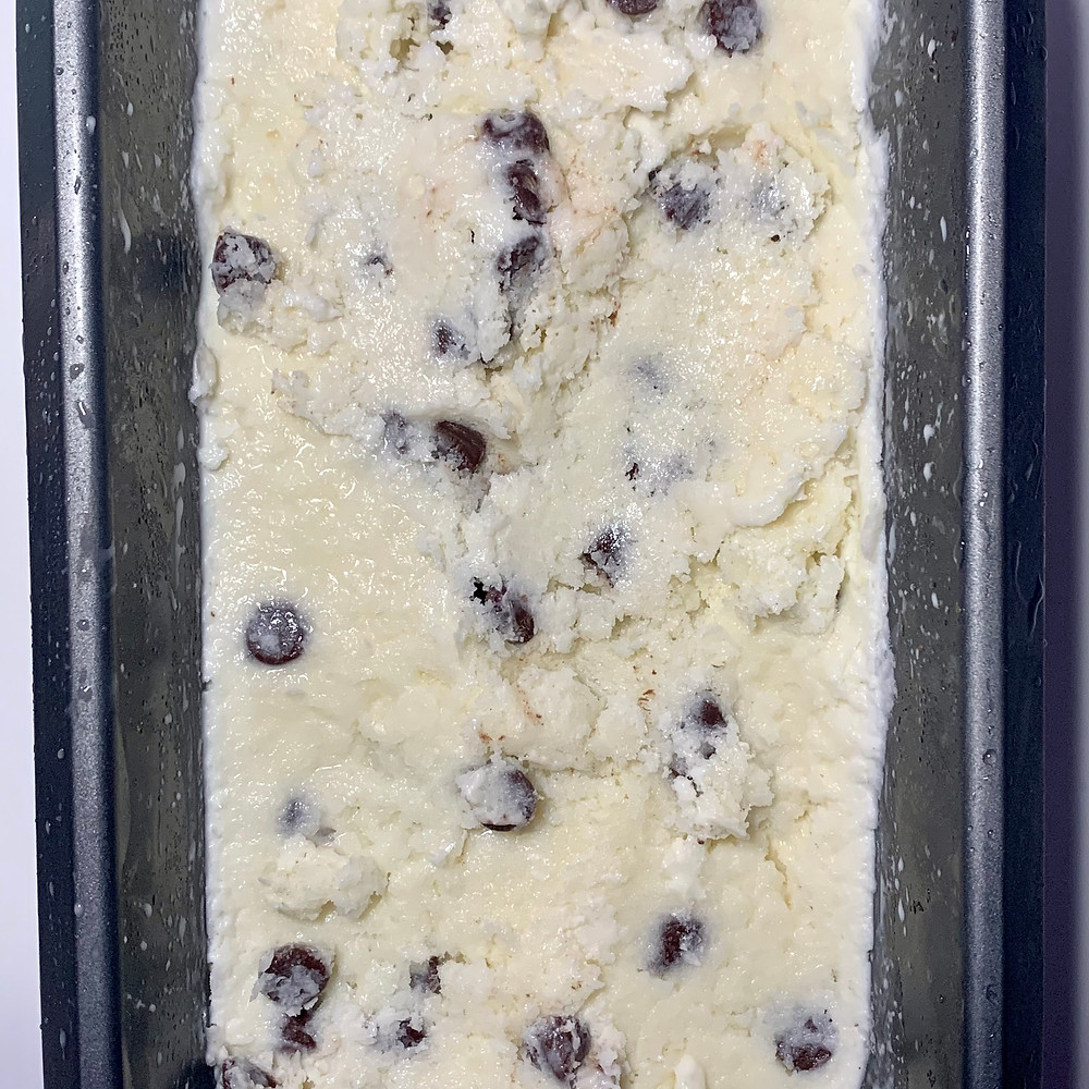 Frozen homemade chocolate chip ice cream in a metal loaf tin