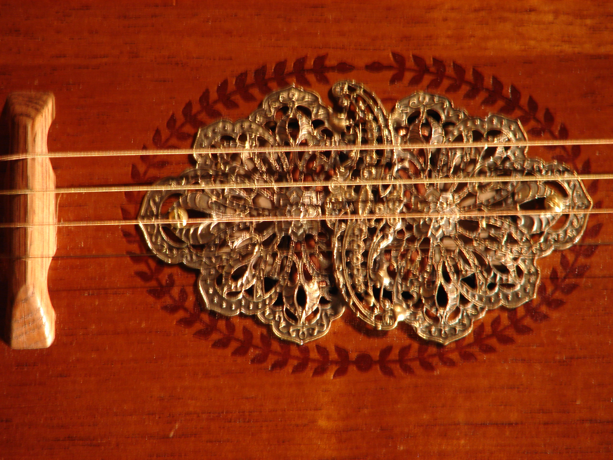 Ornate brass sound hole cover