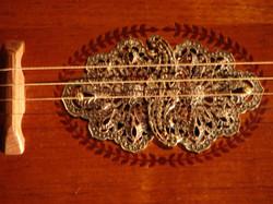 Ornate brass sound hole cover