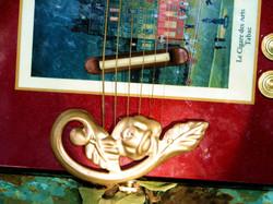 Gold Floret tailpiece-bridge