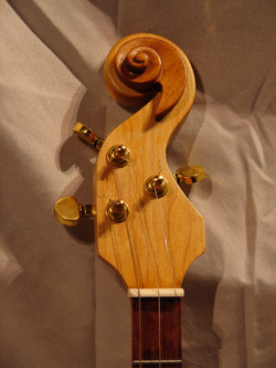 Hand carved maple neck & headstock.