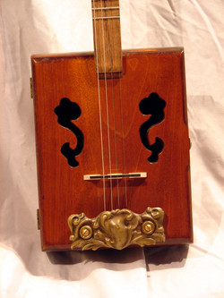 Sound Holes and Antique Tailpiece