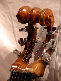 Hand carved walnut head stock