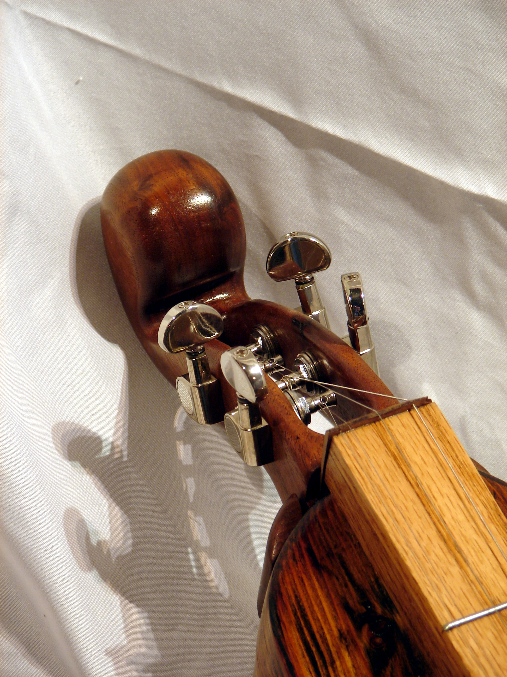 Hand carved walnut head stock
